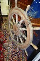 Large old turned wooden ship's wheel metal fitting