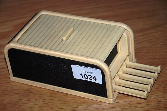 Vintage 'Rolinx' bakelite cigarette dispenser with