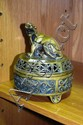 A cast bronze lidded incense burner, pierced