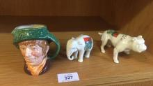 2 Arcadian china models, one of Bill Sykes bulldog and one of an elephant, together with a Royal Doulton character jug ''Arriet'