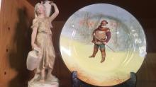 2 items: a Royal Doulton  series plate 'Falstaff' D3596, 26cm D together with a Royal Dux figurine, maiden water carrier with pink triangle lozenge to underside and impressed numbers 2296, note hairline crack to base, 28.5cm T