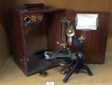Early 20thC antique laboratory microscope, brass and black metal by W. Watson & Sons, of London, on a 3-footed base, comes with original cedar case and large number of accessories