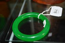Chinese green jade bangle, 7.8cm D