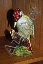 Beswick figurine of a woodpecker sitting on a