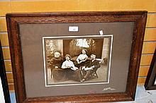 Antique black & white photograph showing a family