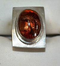 Silver ring set with tiger eye setting