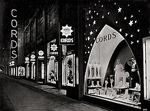 Illuminated Advertising Signs: Views of signs and shop windows in various German cities at night