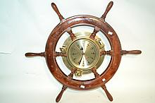 Vintage Ship's Time Clock in Wheel A fine brass hatch style clock mounted in the center of a repilica wooden ships wheel. 9