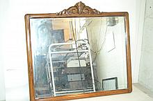 Antique Oak Mirror A fine late Victorian era piece with a carved flourish on top.