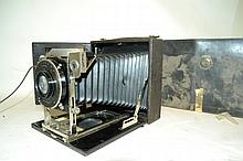 Antique Primo Camera A full sized accordion style camera here with leather case, film disks and a hood.