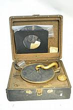 Antique Portable Victrola In a state of disrepair, though it apears to be repairable. In the original case with a record and some spare parts. Approx. 18x18x8 inches.