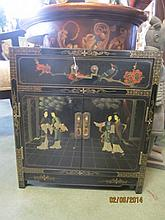 Small Oriental Cabinet This fine piece features hand painted Chinese court scenes on the top and front, accented by birds on flowering branches on the sides. One drawer over a double door cabinet.