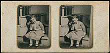 STEREOSCOPIC TINTYPE, a child on a staircase.