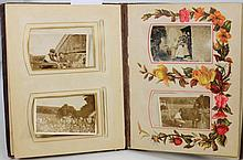 An empty cabinet photographs album with tooled mor
