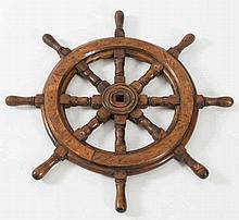 A  small teak ship's helm:, 64cm diameter.