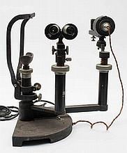 An optometrist's slit lamp by Hamblin, London:, wi