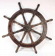 A teak and iron ship's helm:, 100cm diameter.