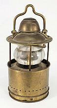 A circular brass ship's lamp:, the shaped swing ha