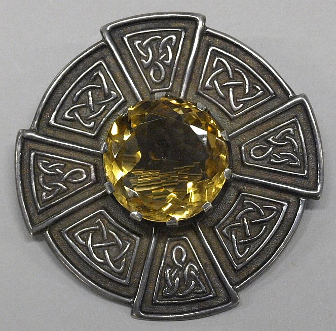 A Scottish silver cloak brooch:, of shaped