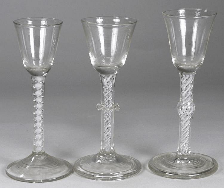 A group of three Dutch wine glasses one with round