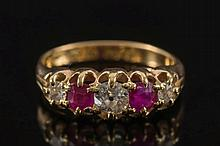 An 18ct gold, diamond and ruby five stone ring:, w