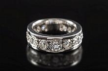 Larry. A diamond mounted eternity ring: pave-set w