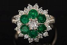 An emerald and diamond circular cluster ring: the