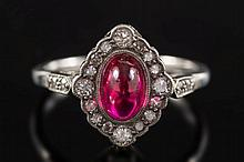 A synthetic ruby and diamond, oval cluster ring:,