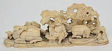 A Chinese carved ivory figure group: of a farmer s