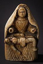 A continental carved alabaster group of the Pieta: