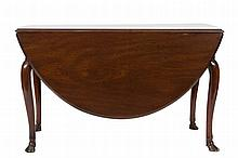 A George II mahogany drop flap dining table:, the