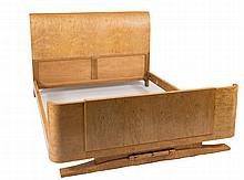 An Art Deco burr maple king size bed:, with shaped