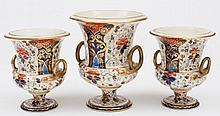 A garniture of three Derby vases: of campana form