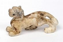 A Chinese carved jade figure of a Buddhist lion: t