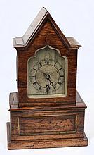 An English Regency rosewood mantel clock: the eigh
