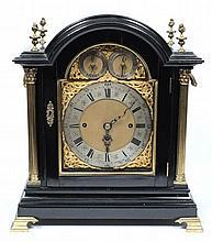 A Victorian ebonised chiming bracket clock: the ei