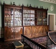 An impressive George III mahogany breakfront libra