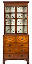 A George IV mahogany and inlaid secretaire bookcas