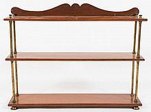 A 19th Century teak three tier open bookcase:, the