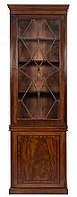 A 19th Century mahogany upright bookcase:, the upp
