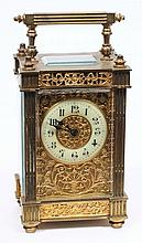 An Edwardian French brass carriage clock with fili