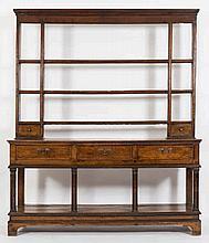 An early 19th Century oak dresser:, the shelved su