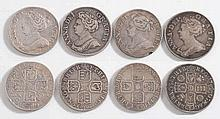 Four Queen Anne shillings: 1705, 1709, 1711, 1712.