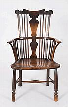 An early 19th Century elm and fruitwood comb back
