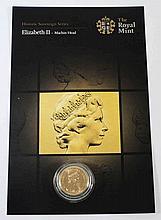 An Elizabeth sovereign 1979: in plastic case.