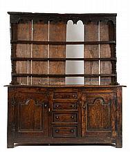 An early 18th Century oak dresser:, the shelved su