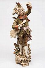 A Royal Dux Bohemia porcelain figure of a minstrel