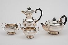 A George VI silver four piece tea service, maker