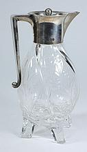 A late Victorian silver mounted glass claret jug,