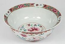 A Chinese famille rose bowl: with moulded and